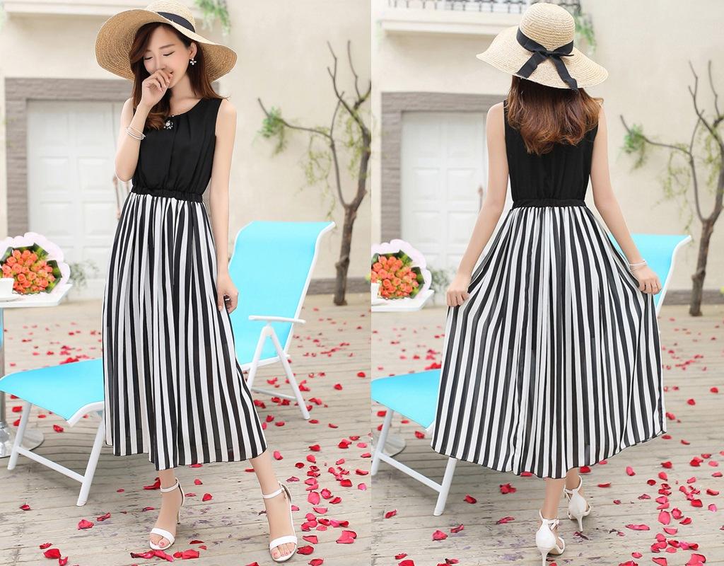 Một chiếc váy maxi kẻ sọc giúp cô nàng có chiều cao khiêm tốn trông nhẹ nhàng và cao hơn